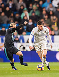 Mateo Kovacic (r) of Real Madrid battles for the ball with Juanmi Jimenez of Real Sociedad during their La Liga match between Real Madrid and Real Sociedad at the Santiago Bernabeu Stadium on 29 January 2017 in Madrid, Spain. Photo by Diego Gonzalez Souto / Power Sport Images