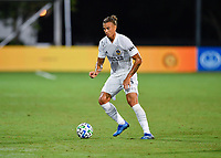 LAKE BUENA VISTA, FL - JULY 18: Rolf Feltscher #25 of LA Galaxy with the ball during a game between Los Angeles Galaxy and Los Angeles FC at ESPN Wide World of Sports on July 18, 2020 in Lake Buena Vista, Florida.