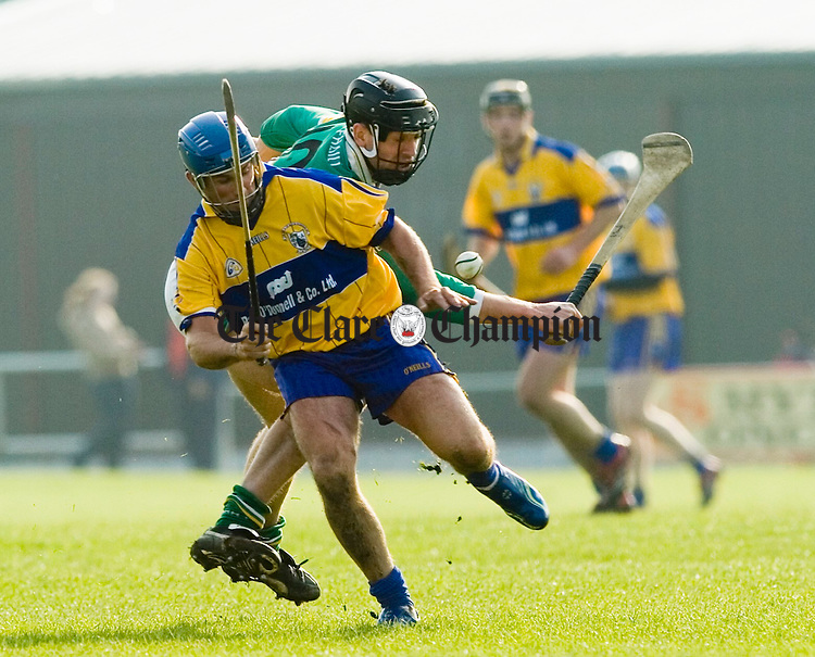 Offaly's Gary Hanniffey and Clare's Alan Markham contest a  ball. Photograph by John Kelly.