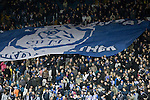 Sheffield Wednesday 2 Peterborough 1, 20/01/2010. Hillsborough, Championship. Supporters passing a large flag down the Kop stand before Sheffield Wednesday take on Peterborough United in a Coca-Cola Championship match at Hillsborough Stadium, Sheffield. The home side won by 2 goals to 1 giving Alan Irvine his third straight win since taking over as Wednesday's manager. Photo by Colin McPherson.