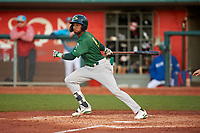 Beloit Snappers Marcos Brito (6) hits a double during a Midwest League game against the Lansing Lugnuts at Cooley Law School Stadium on May 4, 2019 in Lansing, Michigan. Beloit defeated Lansing 2-1. (Zachary Lucy/Four Seam Images)