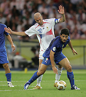 Italian midfielder (8) Gennaro Gattuso takes the ball away from French midfielder (10) Zinedine Zidane.  Italy defeated France on penalty kicks after leaving the score tied, 1-1, in regulation time in the FIFA World Cup final match at Olympic Stadium in Berlin, Germany, July 9, 2006.