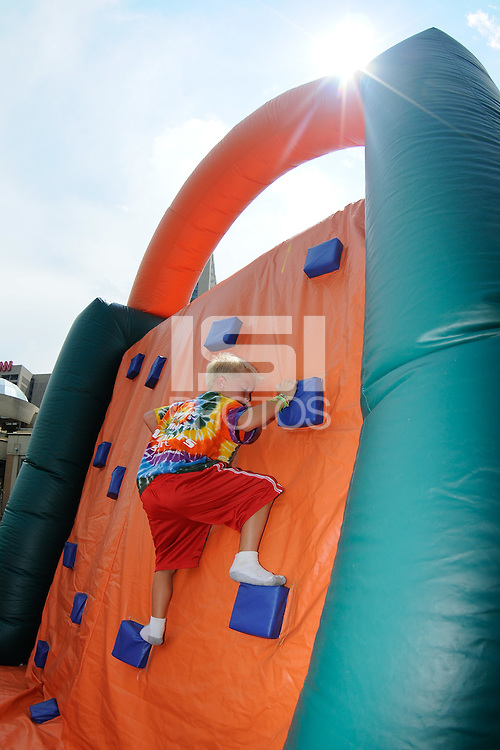 A kid plays on an inflatable during the Women's Professional Soccer (WPS) All-Star Fan Fest at Centennial Olympic Park in Atlanta, GA, on June 28, 2010.