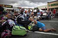 Evacuees displaced by flood waters from Hurricane Harvey wait to board school buses bound for Louisiana in Vidor, Texas, U.S., on August 31, 2017.