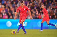 ORLANDO, FL - NOVEMBER 15: Aaron Long #3 of the Unites States dribbles with the ball during a game between Canada and USMNT at Exploria Stadium on November 15, 2019 in Orlando, Florida.
