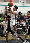 The Meadows' Max Newman goes up for a shot during a semi-final game in the NIAA 2A State Basketball Championships between The Meadows and West Wendover high schools at North Valleys High School in Reno, Nev, on Friday, Feb. 24, 2012. West Wendover won 65-62..Photo by Cathleen Allison