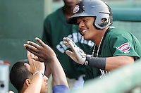Outfielder Reynaldo Rodriguez (47) of the Greenville Drive is congratulated after hitting a home run in the first inning of a game against the Rome Braves on Aug. 10, 2010, at Fluor Field at the West End in Greenville, S.C. Photo by: Tom Priddy/Four Seam Images