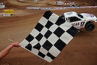 Mar. 20, 2011; Chandler, AZ, USA;  LOORRS pro four driver Carl Renezeder takes the checkered flag during round two at Firebird International Raceway. Mandatory Credit: Mark J. Rebilas-
