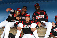 Batavia Muckdogs Iramis Olivencia, Aaron Blanton, Javier Lopez (sitting on top bench) and Rodrigo Vigil (sitting on lower bench) before a game against the Mahoning Valley Scrappers on August 22, 2014 at Dwyer Stadium in Batavia, New York.  Mahoning Valley defeated Batavia 2-1.  (Mike Janes/Four Seam Images)