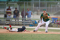 South Vermont Mountaineers first baseman Ryan Serrato (25) waits for a throw as Bryan Sternig (1) dives safely back to the bag during a game against the Edgewood Eagles on March 18, 2019 at Lee County Player Development Complex in Fort Myers, Florida.  South Vermont defeated Edgewood 19-6.  (Mike Janes/Four Seam Images)
