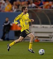 Columbus midfielder Eddie Gaven scans the field as he moves forward at Denver's Invesco Field at Mile High Stadium, April 8, 2006.