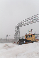 The tugboat, Bayfield, appears locked in the icy drifts of Canal Park during the start of the snow storm.