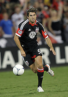 WASHINGTON, DC. - AUGUST 22, 2012:  Dejan Jakovic (5) of DC United races to the ball against the Chicago Fire during an MLS match at RFK Stadium, in Washington DC,  on August 22. United won 4-2.