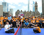 Toronto 2015.<br /> Toronto Mayor John Tory and Toronto 2015 CEO Saad Rafi take part in a Sitting Volleyball demonstration with volunteers at Nathan Phillips Square  // Le maire de Toronto John Tory et le PDG de Toronto 2015 Saad Rafi prennent part à une démonstration de volleyball assis avec des bénévoles au Nathan Phillips Square. 04/08/2015.
