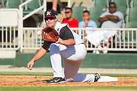 First baseman Dan Black #40 of the Kannapolis Intimidators stretches for a low throw during the South Atlantic League game against the Lakewood BlueClaws at Fieldcrest Cannon Stadium on July 17, 2011 in Kannapolis, North Carolina.  The BlueClaws defeated the Intimidators 4-3.   (Brian Westerholt / Four Seam Images)