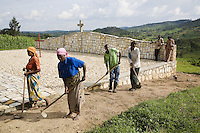 Rwanda. Southern province. Gitisi village. A group of Tutsis, all survivors of the 1994 Genocide, clean and take care of a private memorial grave to the victims of the Genocide.  © 2007 Didier Ruef