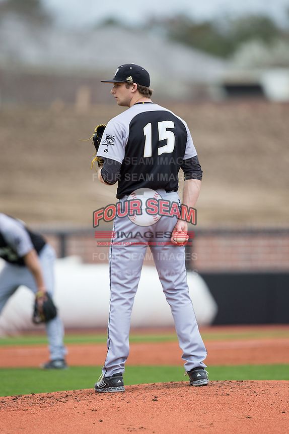 Bryant Bulldogs starting pitcher Kyle Wilcox (15) looks to his catcher for the sign against the Coastal Carolina Chanticleers at Springs Brooks Stadium on March 13, 2015 in Charlotte, North Carolina.  The Chanticleers defeated the Bulldogs 7-2.  (Brian Westerholt/Four Seam Images)