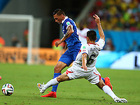 Oscar Duarte of Costa Rica fouls Jose Cholevas of Greece and is shown a second yellow card before being sent off