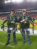 Feb 2, 2020; Miami Gardens, Florida, USA; NHRA funny car driver Ron Capps (left) and brother Jon Capps work as a parabolic microphone holder during the Kansas City Chiefs game against the San Francisco 49ers in Super Bowl LIV at Hard Rock Stadium. Mandatory Credit: Mark J. Rebilas-USA TODAY Sports