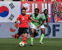 GRENOBLE, FRANCE - JUNE 12: Selgi Jang #16 of the Korean National Team passes the ball as Desire Oparanozie #9 of the Nigerian National Team pressures during a game between Korea Republic and Nigeria at Stade des Alpes on June 12, 2019 in Grenoble, France.