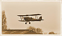 """13/03/15<br /> <br /> **Collect Photo - Best Quality Available**<br /> <br /> Undated file photo showing EM-720 in service.<br /> <br /> ***FULL STORY HERE:   http://www.fstoppress.com/articles/tiger-moth-restorations/    ****<br /> <br /> You may remember spending hours toiling over Airfix models, painstakingly following intricate instructions and trying not to glue your fingers together before painting your own miniature version of one of the RAF's or Luftwaffe's finest aircraft. Then spare a thought for one man who has just helped to restore and put together one World War Two Tiger Moth and is about to start piecing together another FOUR aircraft that were discovered in bits in a barn.<br /> <br /> Sixty-year-old Colin Temple-Smith – who wears a moustache that any Wing Commander would be proud of – has spent a lifetime restoring vintage cars and motorcycles and recently quit his job as a window fitter to help re-build the five bi-planes that will become part of a growing fleet of Tiger Moths at Derbyshire based Blue Eye Aviation.<br /> <br /> Today saw the first of the fully-restored five aircraft take to the skies.<br /> <br /> """"It's just like working on old bikes and cars, although they're a lot more fragile"""" explained Colin, whose wife runs the Aviators Café at Darley Moor Airfield near Ashbourne.<br /> <br /> """"When I was a teenager I used to be a member of a modelling club, making flying models from wood and canvas. They're very similar to build – it's really just the size that's changed with these.<br /> <br /> All Rights Reserved: F Stop Press Ltd. +44(0)1335 418629   www.fstoppress.com."""