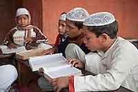 Agra, India.  Boys in Madrasa Reading the Koran.