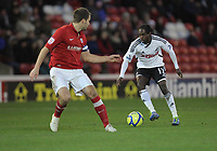 Pictured: Nathan Dyer of Swansea (R). Saturday 07 January 2012<br /> Re: FA Cup football Barnsley FC v Swansea City FC at the Oakwell Stadium, south Yorkshire.