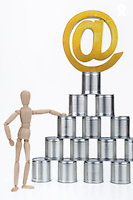 Mannequin, tin cans pyramid, and at sign on top (Licence this image exclusively with Getty: http://www.gettyimages.com/detail/102170465 )