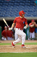 Clearwater Threshers left fielder Adam Haseley (17) follows through on a swing during a game against the Jupiter Hammerheads on April 12, 2018 at Spectrum Field in Clearwater, Florida.  Jupiter defeated Clearwater 8-4.  (Mike Janes/Four Seam Images)
