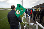 Holker Old Boys 2 Crook Town 1, 10/10/2020. Rakesmoor, FA Vase second round qualifying. A home club official gathering in the corner flags at the end of the match as Holker Old Boys take on Crook Town in an FA Vase second round qualifying tie at Rakesmoor, Barrow-in-Furness. The home club was established in 1936 as Holker Central Old Boys and was initially an under-16 team for former pupils of the Holker Central Secondary School. Holker from the North West Counties League beat their Northern League opponents 2-1, watched by a crowd of 147 spectators. Photo by Colin McPherson.