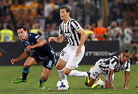Calcio, Supercoppa di Lega: Juventus vs Lazio. Roma, stadio Olimpico, 18 agosto 2013<br /> From left, Lazio midfielder Hernanes, of Brazil, Juventus defender Stephan Lichsteiner, of Switzerland, and midfielder Arturo Vidal, of Chile, during the Italian League Supercup football final match between Juventus and Lazio, at Rome's Olympic stadium,  18 August 2013.<br /> UPDATE IMAGES PRESS/Riccardo De Luca