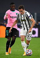 Football Soccer: UEFA Champions League -Group Stage-  Group G - Juventus vs FC Barcellona, Allianz Stadium. Turin, Italy, October 28, 2020.<br /> Juventus' Federico Chiesa (r) in action with Barcellona's Osumane Dembele' (l) during the Uefa Champions League football soccer match between Juventus and Barcellona at Allianz Stadium in Turin, October 28, 2020.<br /> UPDATE IMAGES PRESS/Isabella Bonotto