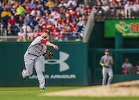 20 May 2014: Cincinnati Reds shortstop Zack Cozart in action against the Washington Nationals at Nationals Park in Washington, DC. The Nationals defeated the Reds 9-4 to take the second game of their 3-game series. Mandatory Credit: Ed Wolfstein Photo *** RAW (NEF) Image File Available ***