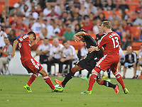 Rafael Teixeira (9) of D.C. United goes against Matias Laba (20) and Steven Cadwell (13) of Toronto FC. Toronto FC defeated D.C. United 2-1, at RFK Stadium, Saturday June 15 , 2013.