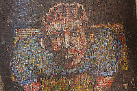 Artist Dickens Otieno fabricated this mosaic like portrait from discarded bottle caps cut into strips and woven into aburlap sack.
