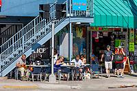 Ft. Lauderdale, Florida.  Sidewalk Breakfast and Souvenirs.