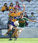 Gavin D'Auria of Clare in action against Dylan Geaney of Kerry during their Munster Minor football final at Pairc Ui Chaoimh. Photograph by John Kelly.