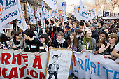 Students and researchers march in Paris, joining up to 3 million people across France during a national strike against the Sarkozy government's economic policies.