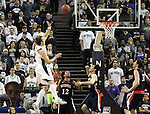 Olek Czyz shoots over the Bucknell defense during a second round NIT college basketball game in Reno, Nev., on Sunday, March 18, 2012. Czyz scored a team-high 24 points in the Nevada 75-67 victory..Photo by Cathleen Allison