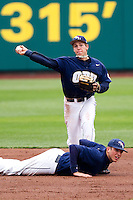Cam Schiller (9) of the Oral Roberts Golden Eagles makes attempts to make a play at first during a game against the Missouri State Bears on March 27, 2011 at Hammons Field in Springfield, Missouri.  Photo By David Welker/Four Seam Images