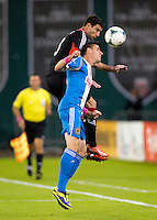 Chris Pontius (13) of D.C. United goes up for a header with Sebastien Le Toux (11) of the Philadelphia Union during a Major League Soccer game at RFK Stadium in Washington, DC. D.C. United tied the Philadelphia Union, 1-1.