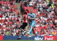 28th May 2018, Wembley Stadium, London, England;  EFL League 2 football, playoff final, Coventry City versus Exeter City; Jack Grimmer of Coventry City heads the ball over Hiram Boateng of Exeter City