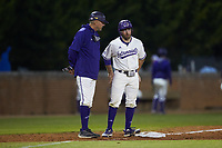 Western Carolina Catamounts head coach Bobby Moranda talks to Seth Graves (33) during the game against the St. John's Red Storm at Childress Field on March 13, 2021 in Cullowhee, North Carolina. (Brian Westerholt/Four Seam Images)