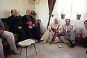 Irak 2002<br /> Assis, au centre, Mgr Petros Harbol, évêque chaldéen accompagné d'un eveque de passage chez des habitants de  Levo<br /> Kurdistan Iraq 2002<br /> On the floor, Bishop Petros Harbol with christian visitors in a house of Levo