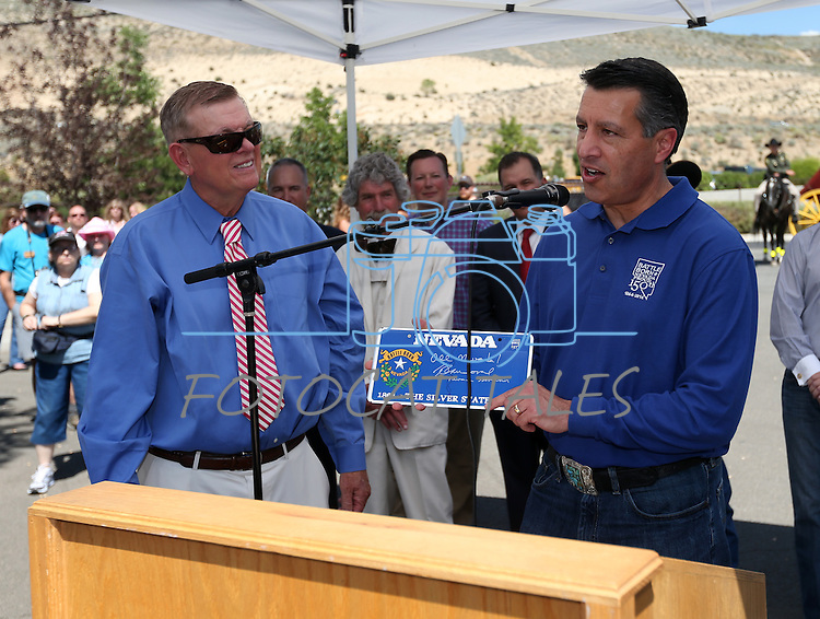 Gov. Brian Sandoval honors retired Judge Roby Willis during the ribbon-cutting ceremony at the NV150 Fair at Fuji Park, in Carson City, Nev., on Thursday, July 31, 2014.<br /> Photo by Cathleen Allison