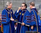 May 17, 2015; Alfredo Quiñones-Hinojosa blows a kiss to the crowd after University of Notre Dame President Rev. John Jenkins, C.S.C. (left) and Notre Dame Board of Trustees Chairman Richard Notebaert awarded him an honorary doctorate at the 2015 Commencement ceremony. (Photo by Barbara Johnston/University of Notre Dame)