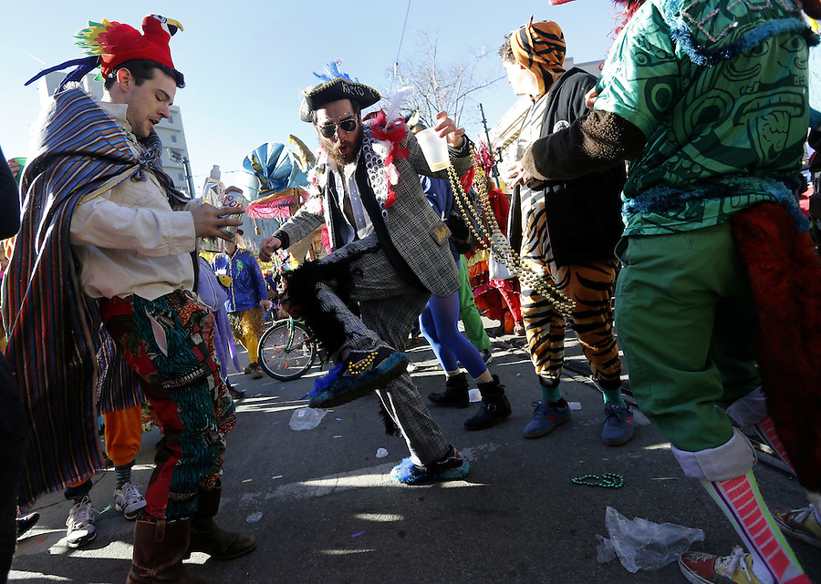 NEW ORLEANS, LOUISIANA - FEBRUARY 9, 2016:  Members of the Mondo Kayo Social and Marching Club parade down St. Charles Avenue during Mardi Gras day on February 9, 2016 in New Orleans, Louisiana. Fat Tuesday, or Mardi Gras in French, is a celebration traditionally held before the observance of Ash Wednesday and the beginning of the Christian Lenten season. (Photo by Jonathan Bachman/Getty Images)