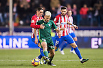 Daniel Ceballos Fernandez 'Dani Ceballos' (c) of Real Betis Balompie competes for the ball with Fernando Torres (l) and Yannick Ferreira Carrasco of Atletico de Madrid during their La Liga 2016-17 match between Atletico de Madrid vs Real Betis Balompie at the Vicente Calderon Stadium on 14 January 2017 in Madrid, Spain. Photo by Diego Gonzalez Souto / Power Sport Images