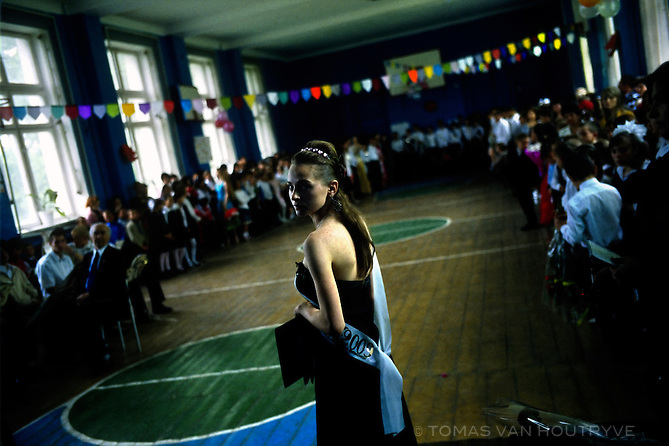 A student girl acts as master of ceremonies for the graduation ceremony of the Gymnasia-Internat Number 2 boarding school in Chisinau, Moldova on 29 May 2009. The school has over 500 children living on the campus. Around 80% are social - children whose parents are still alive, but were turned over to institutional care by the parents.
