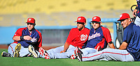 23 July 2011: Members of the Washington Nationals relax before batting practice and a game against the Los Angeles Dodgers at Dodger Stadium in Los Angeles, California. Pictured (left to right) are Laynce Nix, Ian Desmond, Ryan Zimmerman, and Wilson Ramos. The Dodgers rallied to defeat the Nationals 7-6 on a Rafael Furcal walk-off, RBI double in the bottom of the 9th inning. Mandatory Credit: Ed Wolfstein Photo